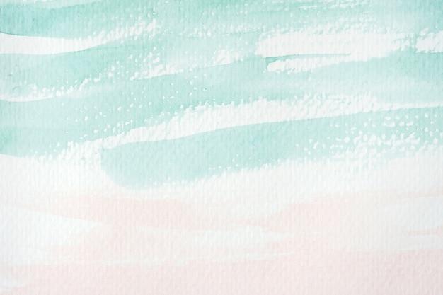 ホワイトペーパーの背景に緑とピンクの抽象的な水彩画のテクスチャ