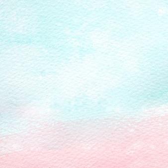 水色の背景、白い紙のバックグラウンドで彩られたアートブルーとピンクの水彩画