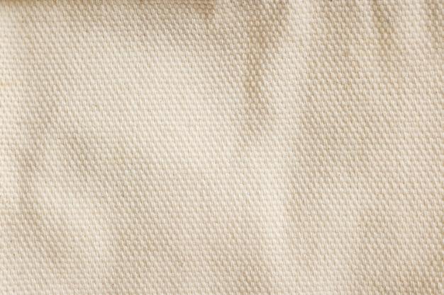 クリームトーン生地表面のパターン背景