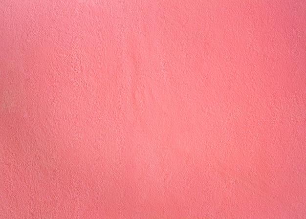 ピンク色によるセメントの壁のテクスチャ
