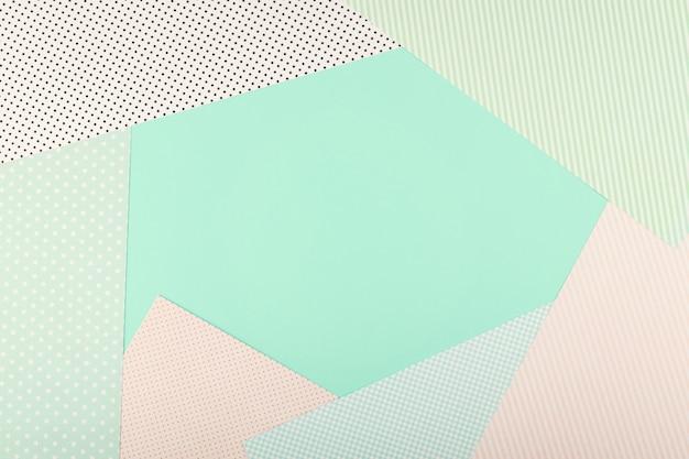ミントブルーとピンクのパステルカラー紙の幾何学的なフラットレイアウト背景。