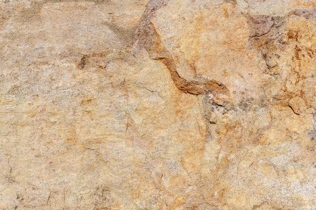 Камень гранитный карьер. рок текстуру фона. камень на фоне горной природы.