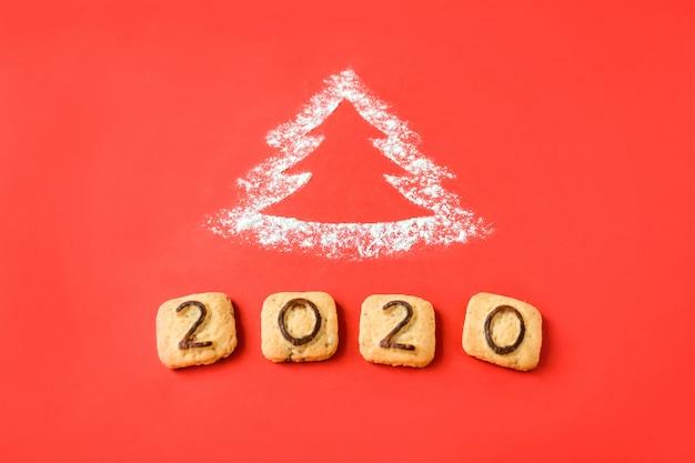 クッキーの数字と小麦粉シルエットクリスマスツリー