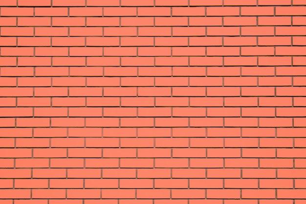 コーラルレンガ壁の背景。リビングコーラルテクスチャレンガ壁、色見本