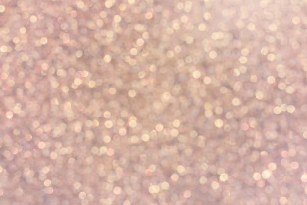 キラキラ光るボケ、ピンクのぼかしの背景。