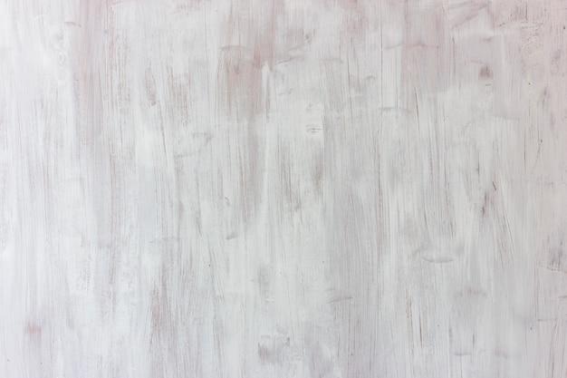白色の背景。広いストロークで描かれた木製の織り目加工ボード