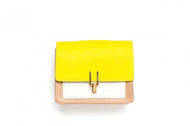 革のハンドバッグの黄色、ベージュ、白の色が分離されました。フラット横たわっていたトップビュー