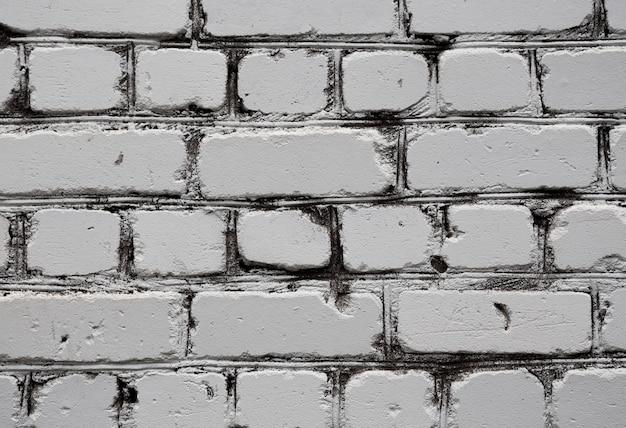 古い白いレンガ壁のテクスチャ背景をクローズアップ。
