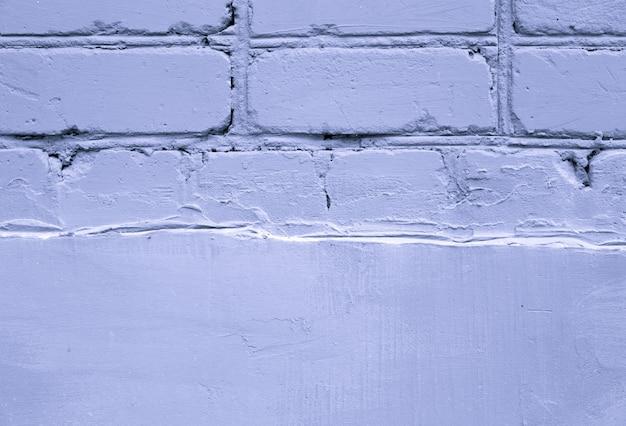 紫の古いれんが造りの壁テクスチャ背景をクローズアップ。テキスト用の空き容量。