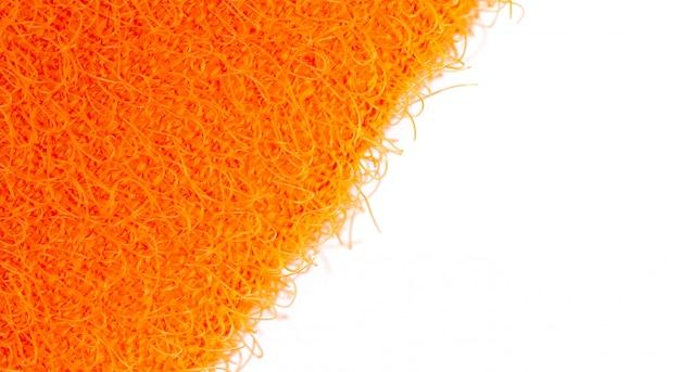 食器マクロを洗浄するためのオレンジ色の表面手ぬぐいの斜めの抽象的なテクスチャ