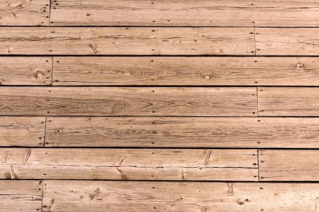 曲がったボードの背景の古い木の床。自然な木の質感。