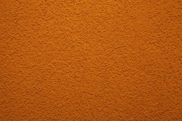 Яркая, красочная текстура бетонной стены, окрашенный фон - оранжевый цвет. обои гипсовые.