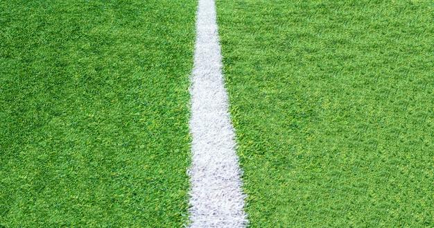 緑の草サッカーフィールドの背景、クローズアップのトップビュー