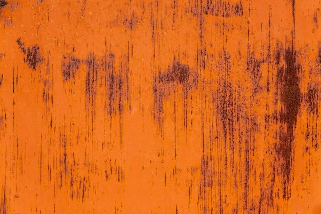 壁にオレンジ錆テクスチャ