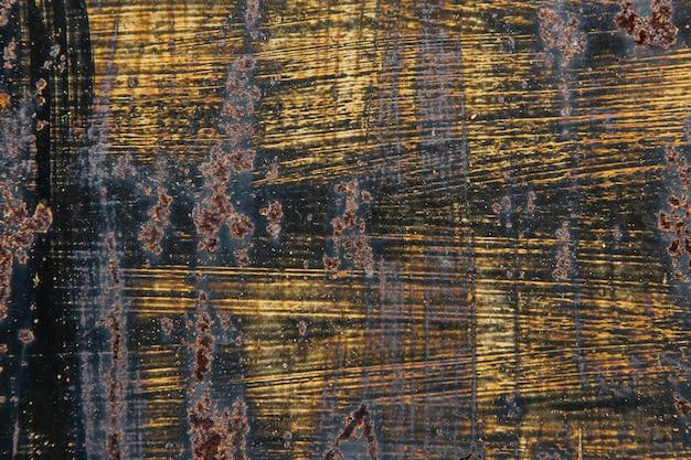 Черно-желтая текстура с ржавчиной на стене