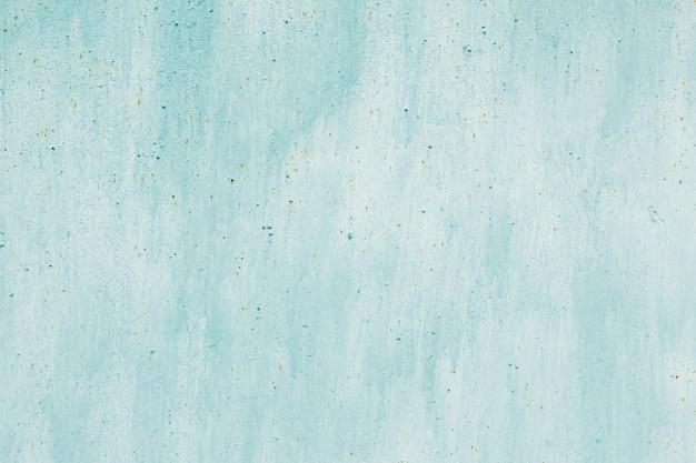 壁にさびた水色のテクスチャ。
