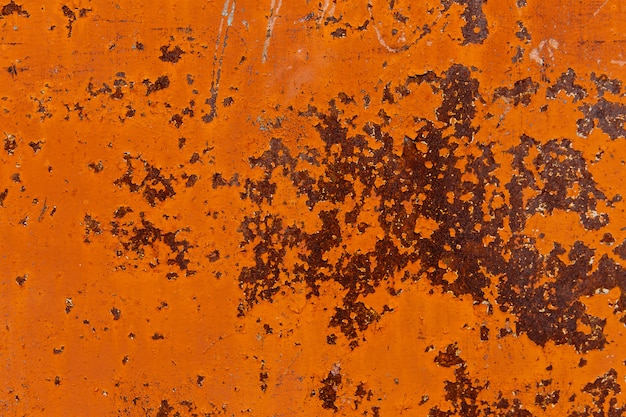 壁にさびたオレンジ色のテクスチャ。