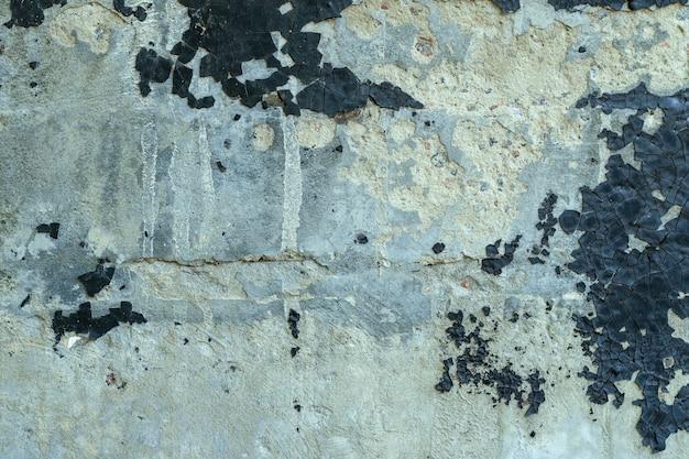 Текстура старого грубого цемента или бетонной стены с треснутой смолой. может использоваться в качестве фона.