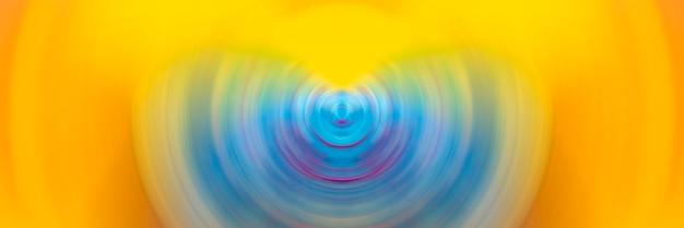 カラフルなスピンサークルラジアルモーションブラーの抽象的な背景。