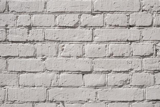 Стена из кирпичного дома. аннотация белом фоне. текстура белого кирпича. белая шероховатая поверхность стены.