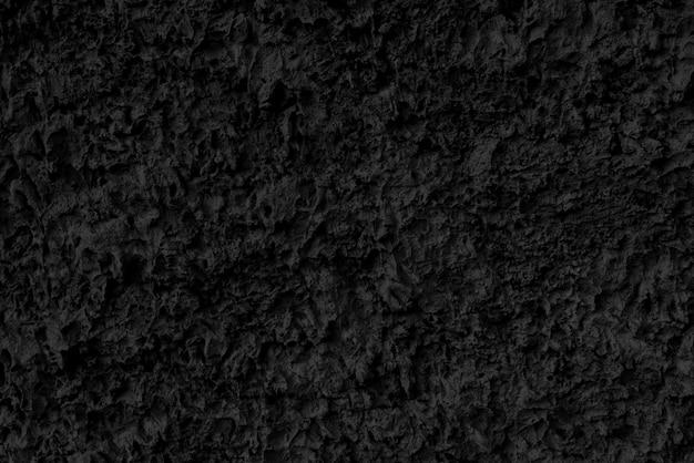 Абстрактный черный фон. черная текстура темная шероховатая поверхность.