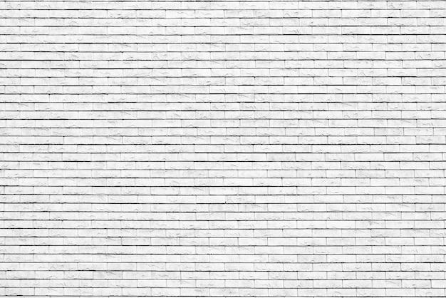 白いレンガの壁。ロフトのインテリアデザイン。ファサードの白いペンキ。