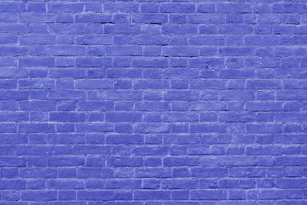 Старая винтажная голубая предпосылка текстурированная кирпичной стеной.