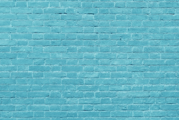 Старая винтажная зеленая предпосылка текстурированная кирпичной стеной.