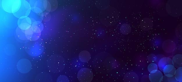 暗闇の中で抽象的な青いぼけボケ光