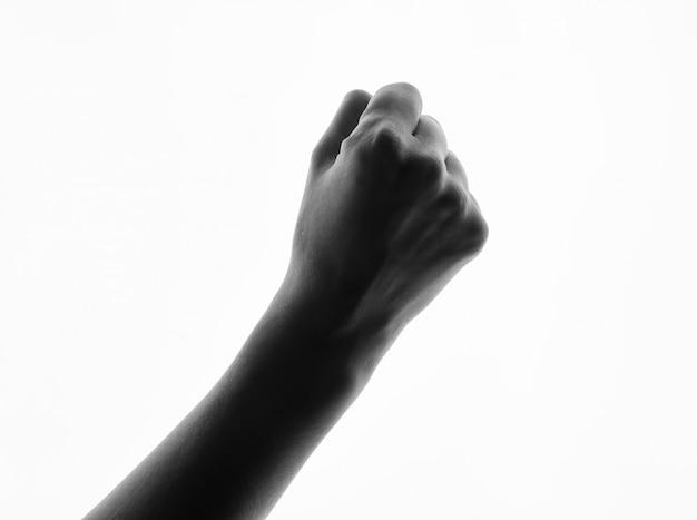 女性手拳黒と白のシルエットの分離。