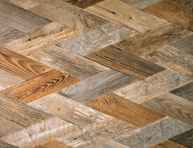 菱形の装飾的な木の板。織り目加工の木製パターン