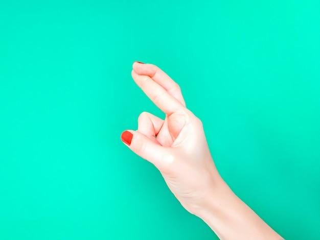 指が交差手サイン