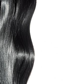 光沢のあるストレートの黒い髪の背景。美しい滑らかなブルネットの髪