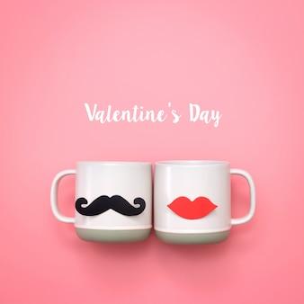ピンクのカップに偽の唇と口ひげの装飾。バレンタインデーと結婚式のコンセプト。