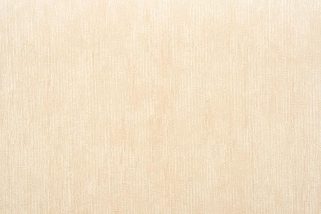 ベージュ色の抽象的な背景のビニールの壁紙の垂直方向の大まかなテクスチャ