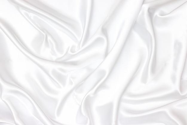 Белая ткань текстуры фона. гладкий элегантный белый шелк можно использовать в качестве свадебного фона.