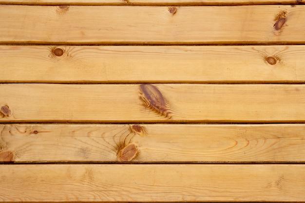 木のテクスチャの背景。隙間、厚板、隙間のある木製パネル。