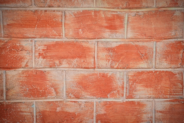 テクスチャのセメントコンクリート石膏と赤またはオレンジ色のレンガパターンの壁