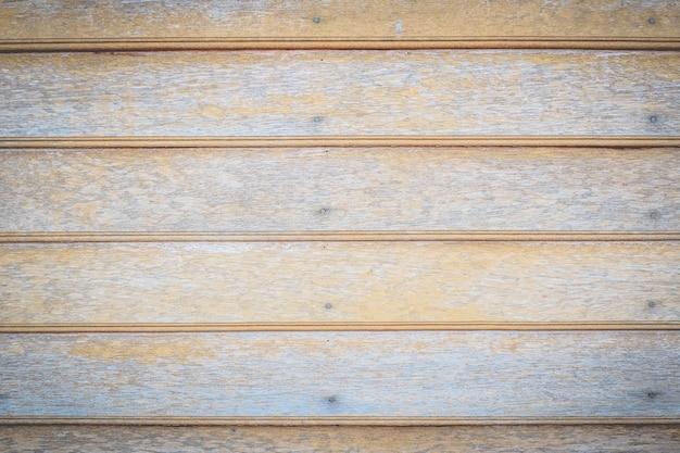 古い茶色の合板ボード木製の壁のテクスチャ背景
