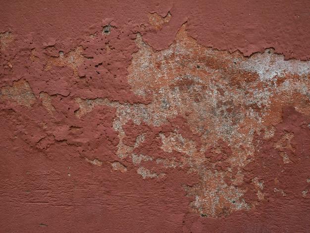 高齢者の背景とテクスチャ古い建物の壁セメントと古い塗料
