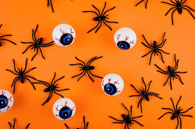 ハロウィーンの背景に目、クモ