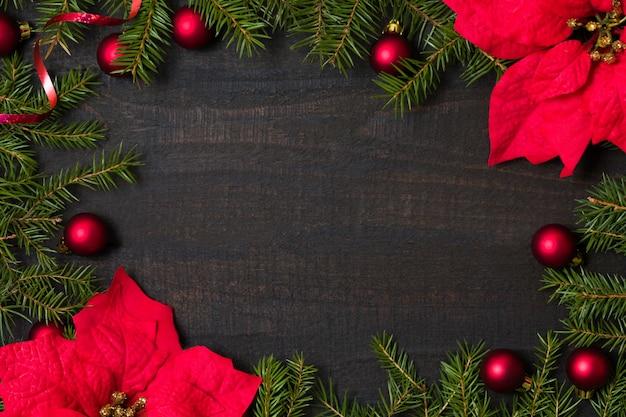クリスマスの装飾と木製のテーブルの背景