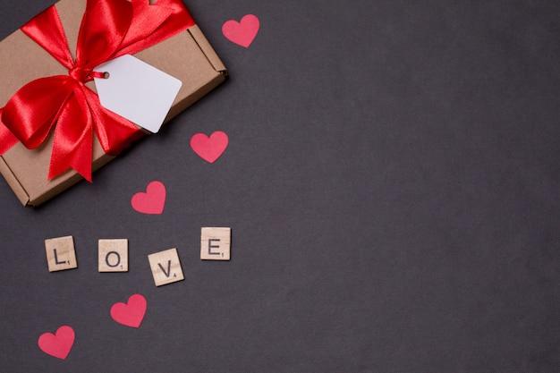 バレンタインの日ロマンチックなシームレス背景、ギフトタグ弓、現在、愛、心