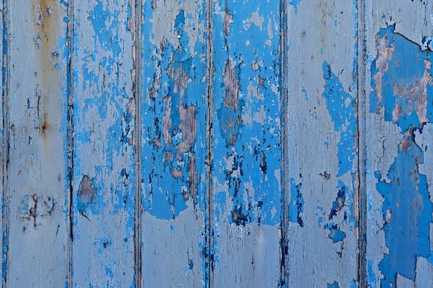 ヴィンテージ塗装の木製の背景の壁の青い色