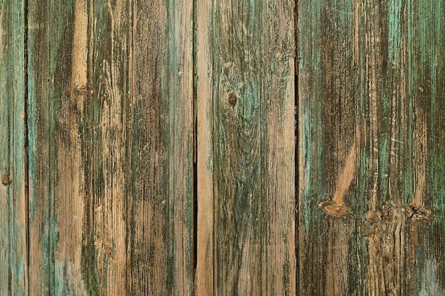 ヴィンテージ塗装木製の背景の壁の緑