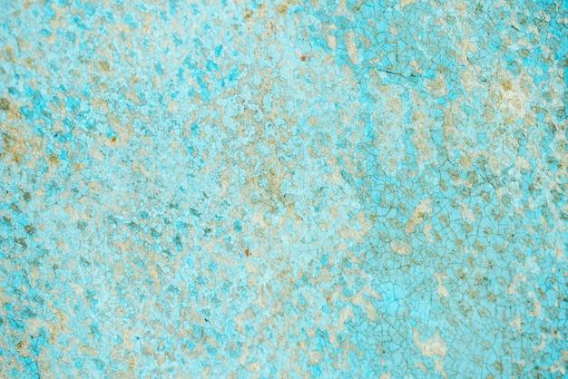 青いターコイズブルーの背景色の錆