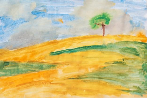 キャンバスに水彩画。黄色のフィールド、緑の芝生と青い空