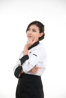 アジアの若いブルネットシェフの女性の肖像画