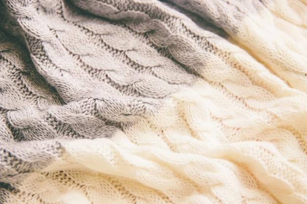 格子縞の毛布暖かいニットのクローズアップ。セレクティブフォーカス