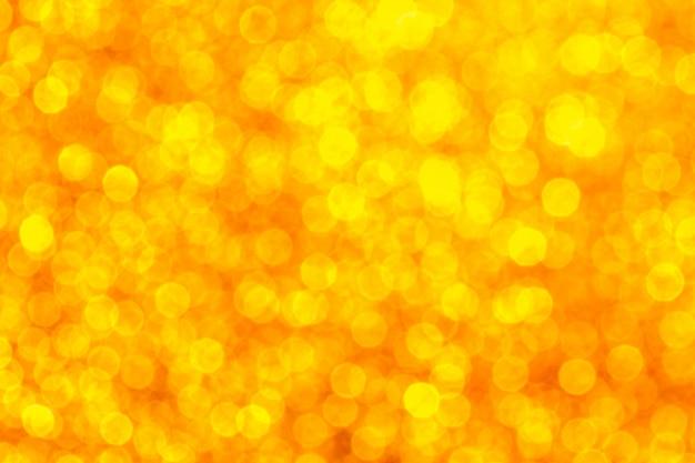 クリスマスの創造的なキラキラゴールドカラーの背景